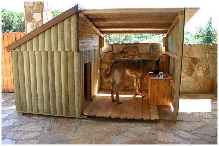 a  wood cabin-style dog house with heater