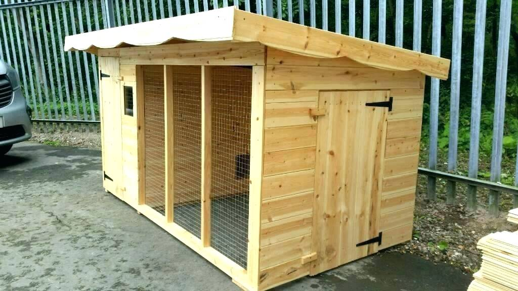 an outdoor dog house with heater made of wood