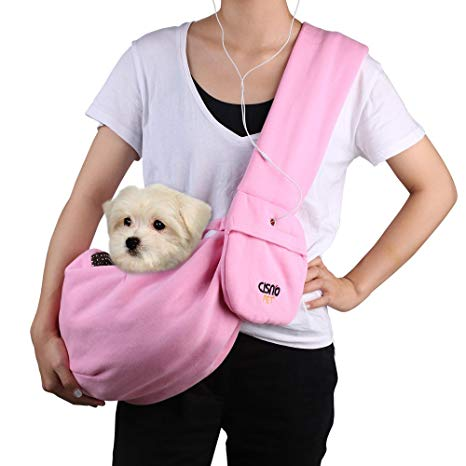 photo of a toy dog on a dog sling worn by a woman